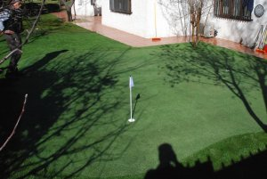 Campo de golf en casa césped artificial